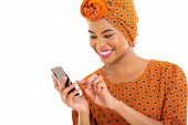 gorgeous african american woman using smart phone on white background
