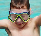 Boy Swimming With Goggles On