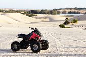 stock photo of four-wheeler  - Quad bike in sand desert in vietnam close - JPG