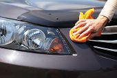 image of wiper  - Hand with microfiber cloth cleaning car - JPG