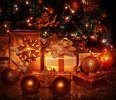 Many different gift boxes wrapped in shiny golden paper under decorated Christmas tree, Christmastime surprises, New Year eve concept