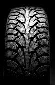 pic of asymmetrical  - winter car tyre on a black background - JPG