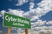 stock photo of monday  - Cyber Monday Just Ahead Green Road Sign with Dramatic Clouds and Sky - JPG