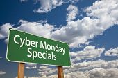 Cyber Monday Specials Green Road Sign with Dramatic Clouds and Sky.