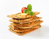 stack of crispy bread with apple and tomato