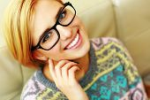stock photo of natural blonde  - Closeup portrait of a young cheerful woman in glasses - JPG