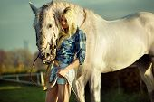 Portrait of young beautiful woman and horse