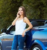 Smiling Caucasian Woman Talking On Phone In A Cabriolet