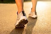 Closeup Of Athlete's Feet Running On Road
