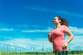 Young Woman Jogging In Wide Field