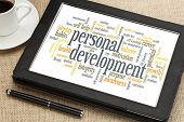 cloud of words or tags related to personal development on a  digital tablet