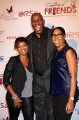LOS ANGELES - NOV 21:  Vanessa Bell Calloway, Magic Johnson, Cookie Johnson at the