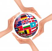 Hands holding globe with flags of world. Raster version