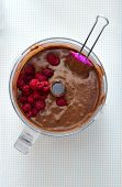 Making Cake - Mixing Chocolate Batter With Raspberries