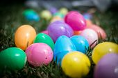 Colorful plastic Easter Eggs in grass