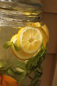 jug of water with lemon and herbs