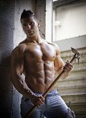 pic of hoe  - Muscular shirtless young man holding farming tool in his hands sweaty in jeans - JPG
