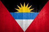 Antigua And Barbuda Flag On Wood Background