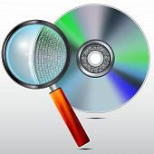 CD or DVD disc and magnifying glass, concept , storages and readings of the digital information.