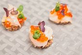 Salmon Eggs, Fish, And Herbs Canapes