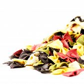 Colored Italian Pasta  Isolated On White Background Close Up.  Fresh Bow Tie Pasta Isolated On White