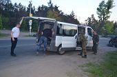 KIEV, UKRAINE - MAY 1, 2014 Checking the transport in the road to Kiev Checkpoint of paramilitary ri