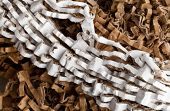pic of reuse recycle  - Recycled corrugated cardboard stripes packaging material close up - JPG