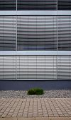 Office building with closed silver shutter blinds