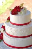 Wedding Cake With Red Stripes And Flowers