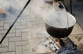 Pot With Food On Metal Rods Vaporize On Fire