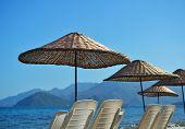 Beach umbrellas against the bay of Marmaris, Turkey