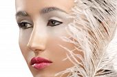 Beauty Closeup Girl With A White Boa Feather