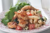 Grilled chicken meat with pasta and vegetables, healthy and rich salad