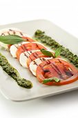 Caprese Salad - Salad with Tomatoes, Mozzarella Cheese, Balsamic Salad Dressing and Pesto Sauce