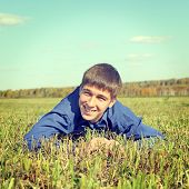 picture of wallow  - Toned photo of Happy Teenager lying in the Field - JPG