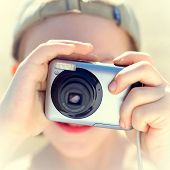 Kid With A Photo Camera