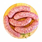 Sausages pork with rosemary on round board