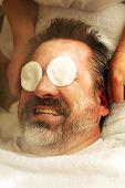 Mature man having facial
