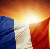French flag in front of bright sky