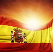 Spanish flag in front of bright sky