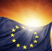 European Union flag in front of bright sky