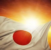 Japanese flag in front of bright sky