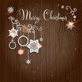 Merry Christmas lettering on wood backdrop. Vector design with place for text.