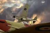 pic of spitfire  - Shot of a Hurricane banking away from a Spitfire into a stormy sky