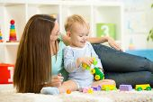 mother and child boy playing together indoor