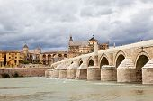 Roman Bridge or Old Bridge over the River Guadalquivir. Cordova. Spain.