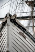 picture of tall ship  - Low Angle Detail of Tall Ship Bow or Stern with Mast in Background - JPG