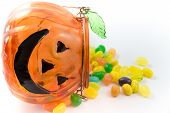 Jelly Beans Dropped From Pumpkin Container Isolated