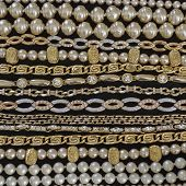 variety of golden jewelry closeup