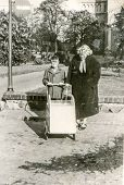 Vintage photo of mother and son with a pram